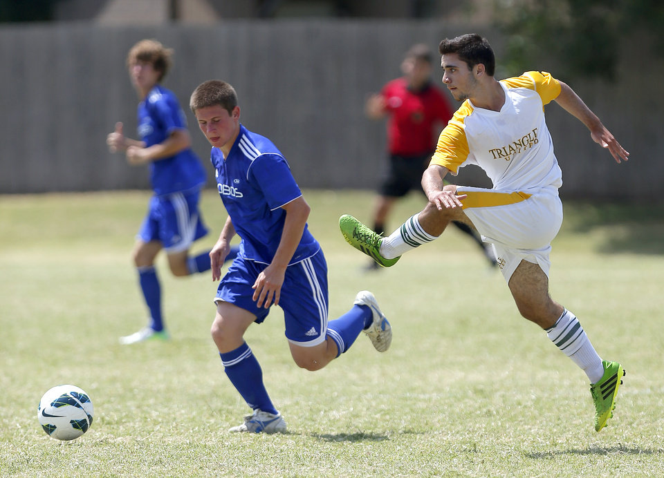 Photo - U.S. YOUTH SOCCER REGION III CHAMPIONSHIPS / YOUTH SOCCER TOURNAMENT: 96 Lobos Rush Blue (TN) Chad Riesenbeck, left, and TUSA Gold (NC) Jonathan Giacona during the 2013 Youth Soccer Southern Regional Championship in Edmond, Okla. Photo by Sarah Phipps, The Oklahoman