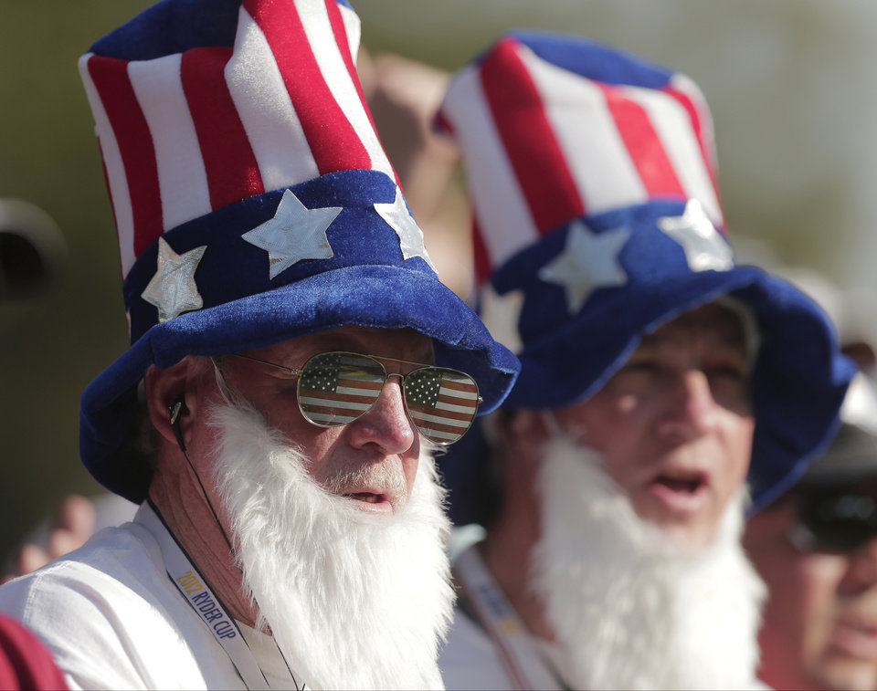 Photo -   Fans watch on the 14th hole during a four-ball match at the Ryder Cup PGA golf tournament Friday, Sept. 28, 2012, at the Medinah Country Club in Medinah, Ill. (AP Photo/Charlie Riedel)