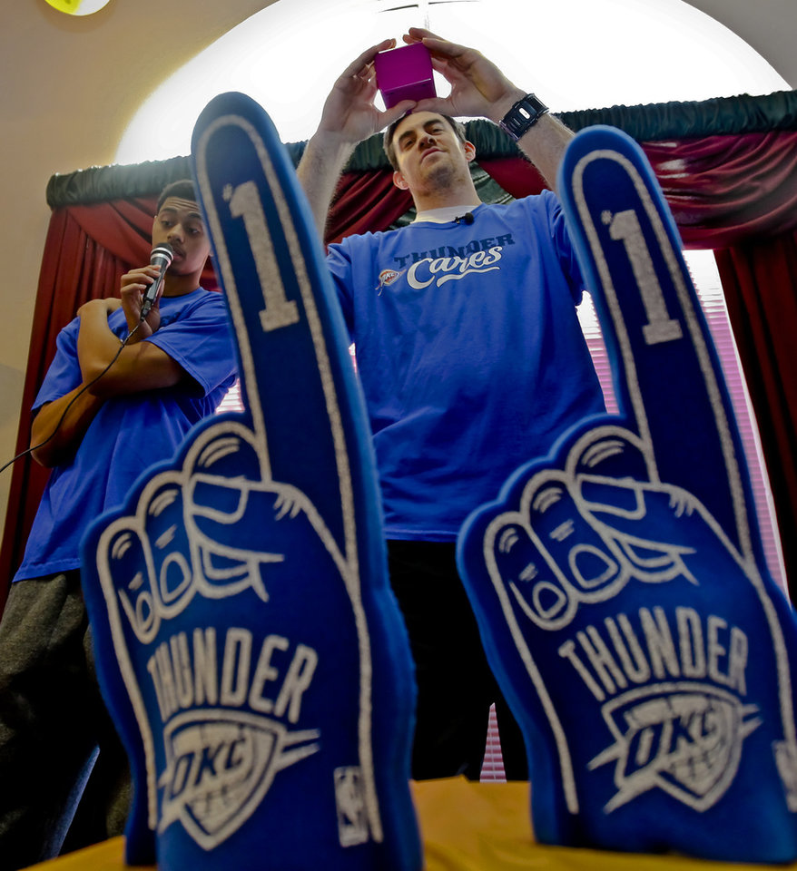 Jeremy Lamb and Nick Collison call out bingo numbers for participants during the Oklahoma City Thunder's 1000th community appearance at Ranchwood Nursing Home on Tuesday, Nov. 27, 2012, in Yukon, Okla.   Photo by Chris Landsberger, The Oklahoman