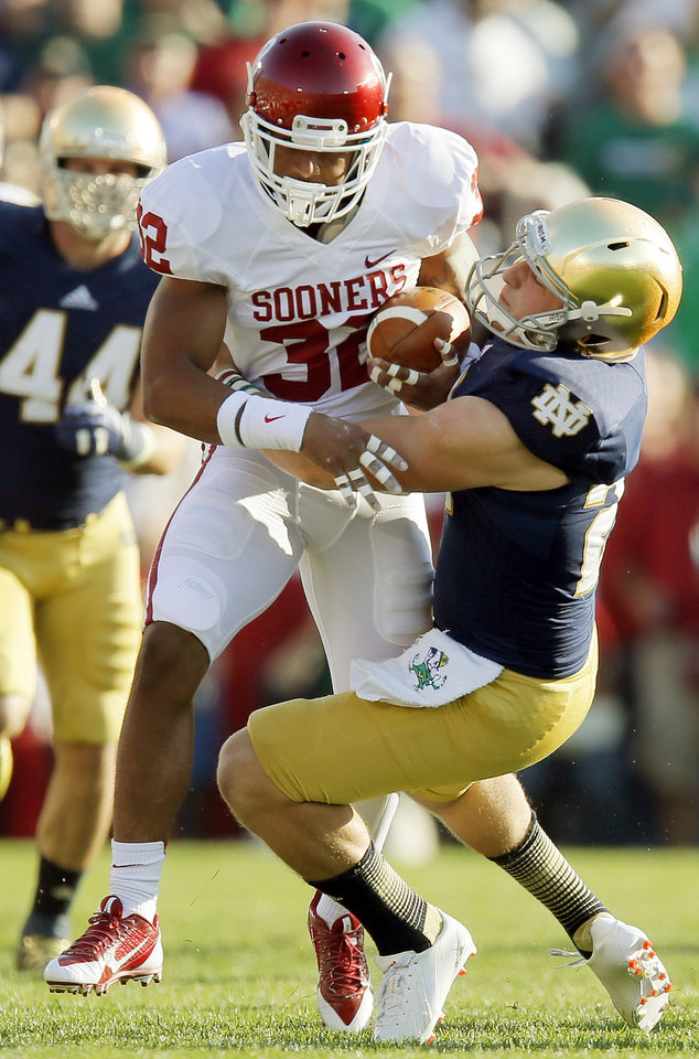 Photo - Oklahoma's Trey Franks (32) is stopped after a long kickoff return in the third quarter during a college football game between the University of Oklahoma Sooners and the Notre Dame Fighting Irish at Notre Dame Stadium in South Bend, Ind., Saturday, Sept. 28, 2013. OU won, 35-21. Photo by Nate Billings, The Oklahoman