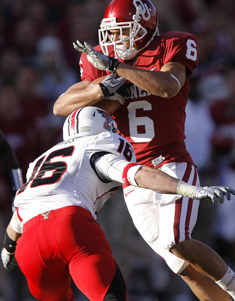 Photo - Oklahoma's Cameron Kenney (6) tries to get past Texas Tech's Cody Davis (16) after a reception during the first half of the college football game between the University of Oklahoma Sooners (OU) and the Texas Tech Red Raiders (TTU) at the Gaylord Family Memorial Stadium on Saturday, Nov. 13, 2010, in Norman, Okla.  Photo by Chris Landsberger, The Oklahoman