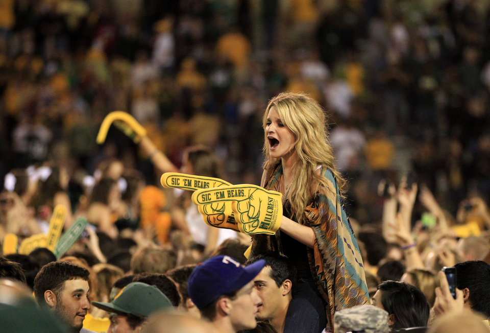 Photo - Baylor fans celebrate after storming the field following their 45-38 win against Oklahoma in an NCAA college football game, Saturday, Nov. 19, 2011, in Waco, Texas. (AP Photo/Tony Gutierrez) ORG XMIT: TXTG218