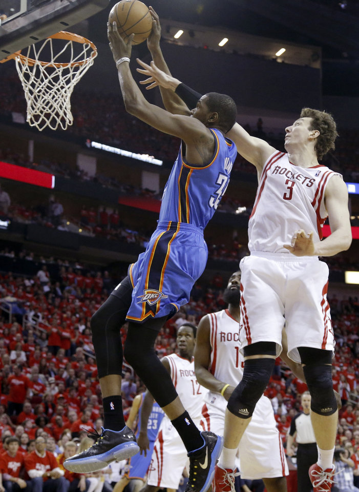 Photo - Oklahoma City's Kevin Durant (35) shoots as Houston's Omer Asik (3) defends during Game 6 in the first round of the NBA playoffs between the Oklahoma City Thunder and the Houston Rockets at the Toyota Center in Houston, Texas, Friday, May 3, 2013. Photo by Bryan Terry, The Oklahoman
