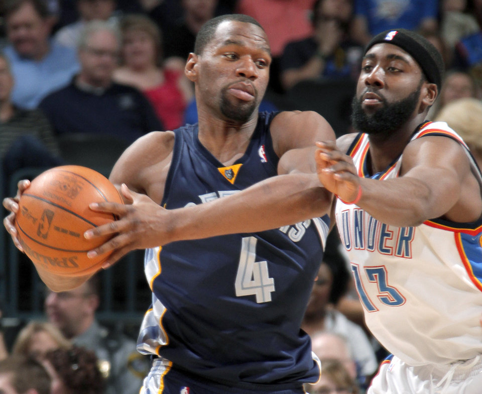 Oklahoma City's James Harden defends Sam Young of Memphis during the NBA basketball game between the Oklahoma City Thunder and the Memphis Grizzlies at the Ford Center in Oklahoma City on Wednesday, April 14, 2010. 