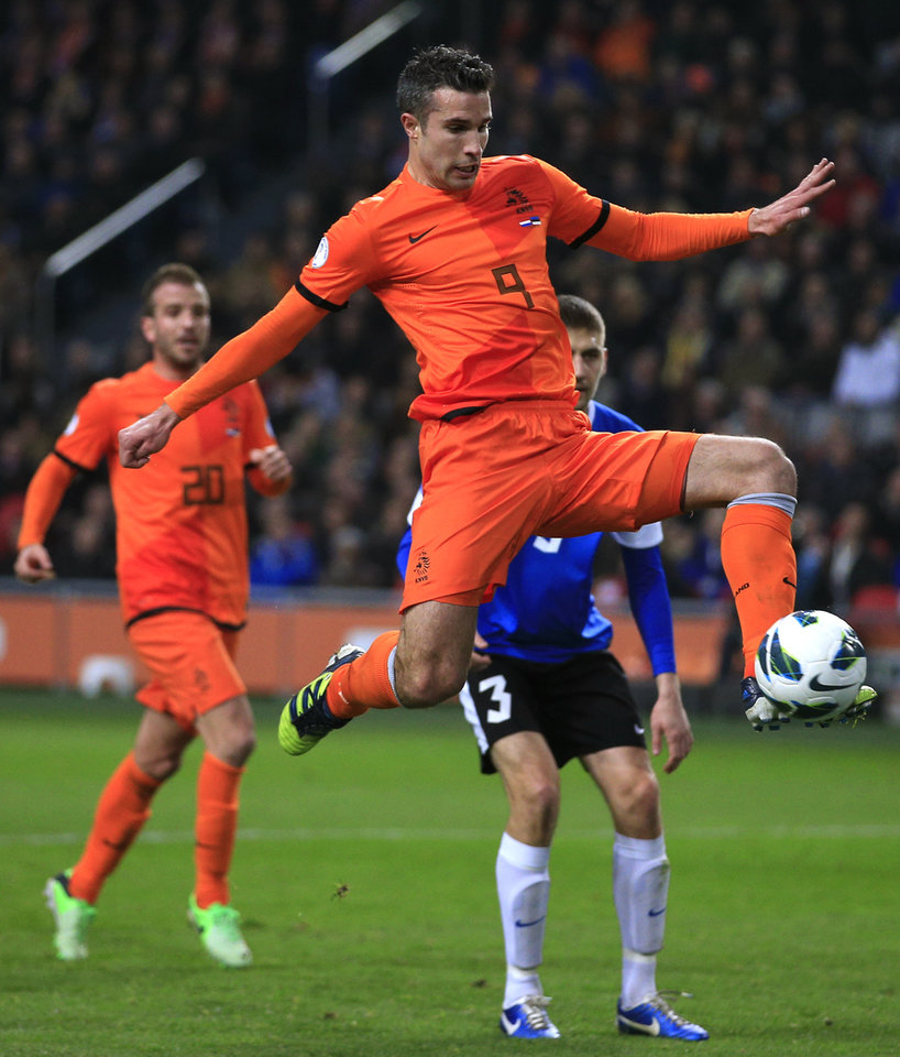 Photo - FILE - In this March 22, 2013, file photo, Robin van Persie of The Netherlands scores 2-0 during the Group D world cup qualifying soccer match Netherlands against Estonia in Amsterdam, Netherlands. Robin van Persie and Arjen Robben continue to spark the Oranje, but Van Persie must seize the opportunity after the Manchester United striker has scored only once at the last two major tournaments, the 2010 World Cup and Euro 2012.  (AP Photo/Peter Dejong, File)