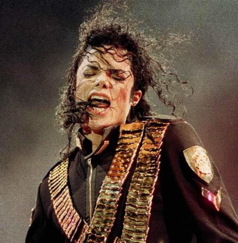 Photo - In this Aug. 29, 1993  file photo, pop singer  Michael  Jackson performs during his