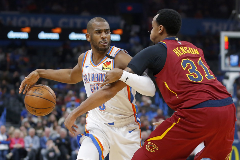Photo - Oklahoma City's Chris Paul (3) goes past Cleveland's John Henson (31) during an NBA basketball game between the Oklahoma City Thunder and the Cleveland Cavaliers at Chesapeake Energy Arena in Oklahoma City, Wednesday, Feb. 5, 2020. [Bryan Terry/The Oklahoman]