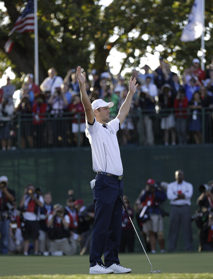 Photo - Europe's Martin Kaymer celebrates after winning the Ryder Cup PGA golf tournament Sunday, Sept. 30, 2012, at the Medinah Country Club in Medinah, Ill. (AP Photo/David J. Phillip)  ORG XMIT: PGA206