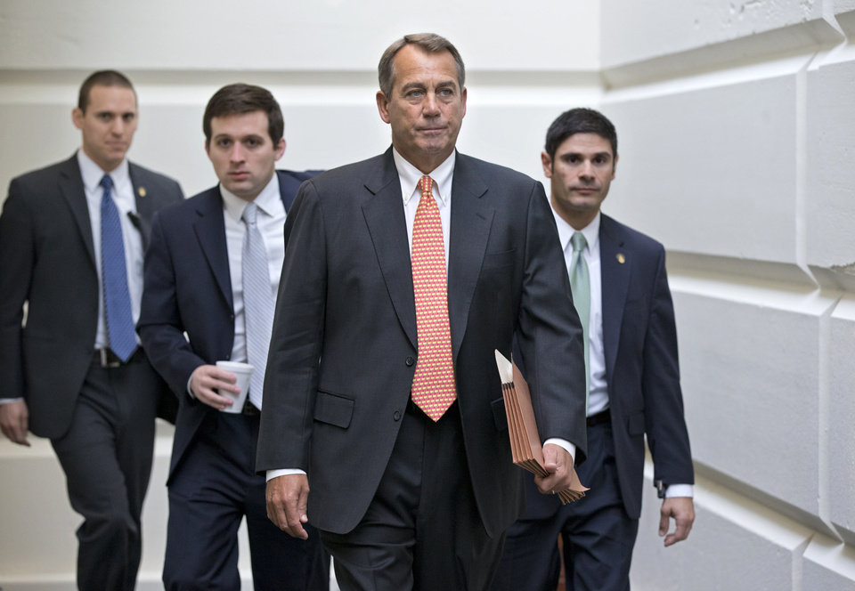 "House Speaker John Boehner of Ohio, who conferred with President Barack Obama yesterday by phone, walks to a closed-door meeting with the GOP caucus, Wednesday, Dec. 12, 2012, on Capitol Hill in Washington. Boehner and the other House Republican leaders are calling for Obama to come up with plan they can accept for spending cuts and tax revenue to avoid the so-called ""fiscal cliff"" of automatic tax hikes and budget reductions. (AP Photo/J. Scott Applewhite)"