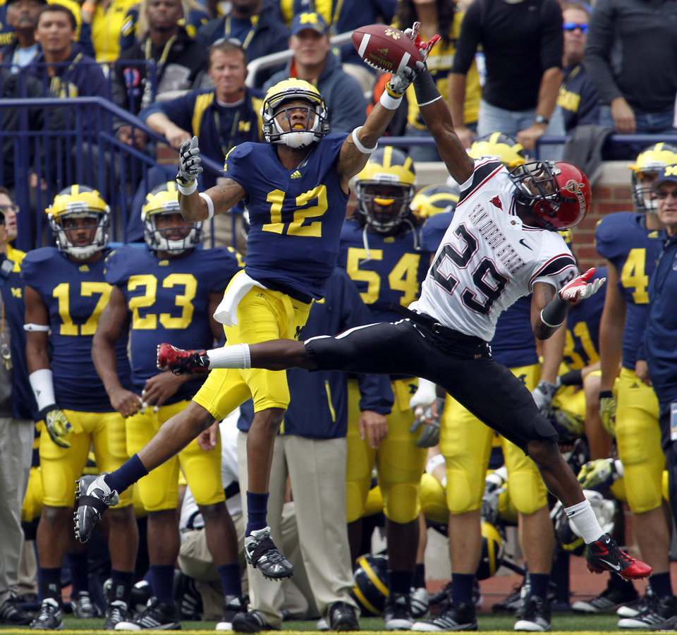 Michigan wide receiver Roy Roundtree (12) has a pass broken up by San Diego State defensive back Larry Parker (29) during the first quarter of an NCAA college football game, Saturday, Sept. 24, 2011, in Ann Arbor, Mich. (AP Photo/Tony Ding)