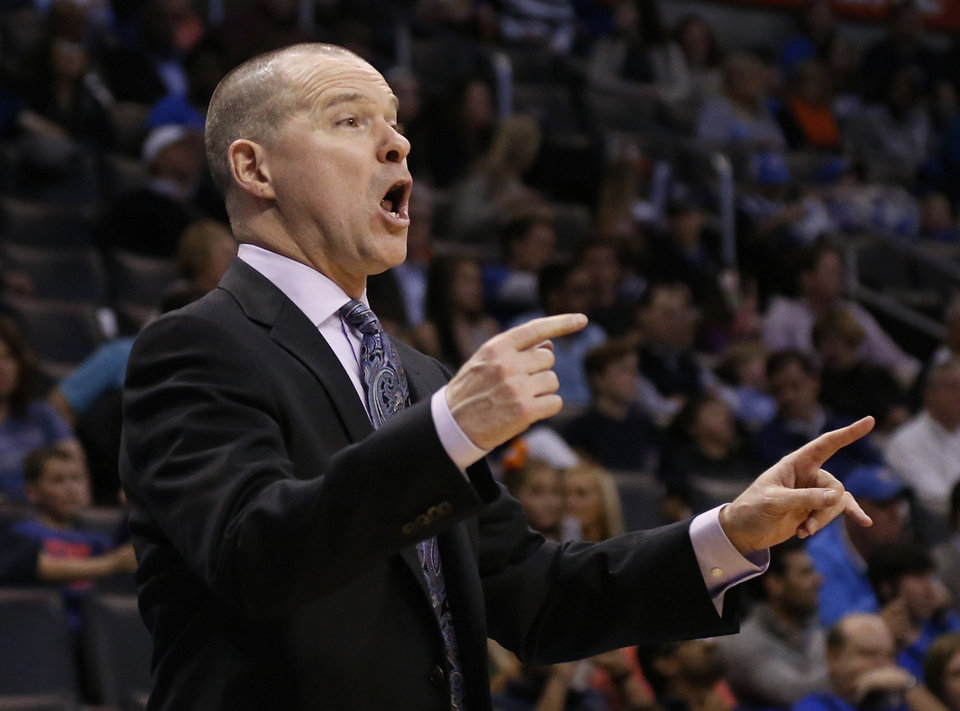Photo - Sacramento Kings head coach Michael Malone directs his team in the fourth quarter of an NBA basketball game against the Oklahoma City Thunder in Oklahoma City, Sunday, Jan. 19, 2014. Oklahoma City won 108-93. (AP Photo/Sue Ogrocki)
