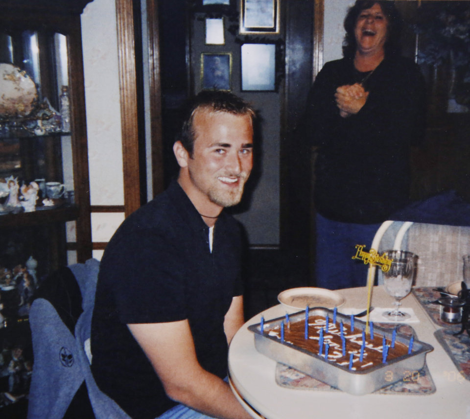 Photo - A photo provided by the family of Michael Tate Reed Jr., showing him with a birthday cake at a recent party for him.  Reed has suffered from serious mental illness for at least two years, his family says. Reed hasnÕt ever been formally diagnosed, but mental health experts have told the family that Reed likely has schizoaffective disorder, a brain disease that is a mix of schizophrenia and bipolar disorder. Reed is at a mental health facility, and his family and friends hope he doesnÕt have to spend time in prison when they say heÕs suffering from a mental illness and is not a terrorist or Satanist, as some have called him after he admitted to law officers that he drove his vehicle onto the lawn of the state Capitol and crashed into the Ten Commandments monument, toppling it from its base and breaking it into several pieces. Photo by Jim Beckel, The Oklahoman