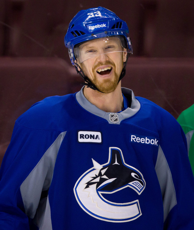 Photo -   Vancouver Canucks' Henrik Sedin, of Sweden, laughs during hockey practice in Vancouver, British Columbia on Tuesday April 10, 2012. The Vancouver Canucks and Los Angeles Kings are scheduled to play game 1 of an NHL Western Conference quarterfinal series Wednesday. (AP Photo/The Canadian Press, Darryl Dyck)
