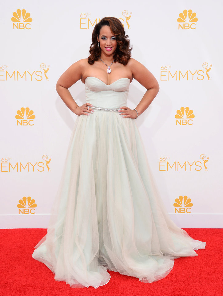 Photo - Dascha Polanco arrives at the 66th Annual Primetime Emmy Awards at the Nokia Theatre L.A. Live on Monday, Aug. 25, 2014, in Los Angeles. (Photo by Jordan Strauss/Invision/AP)