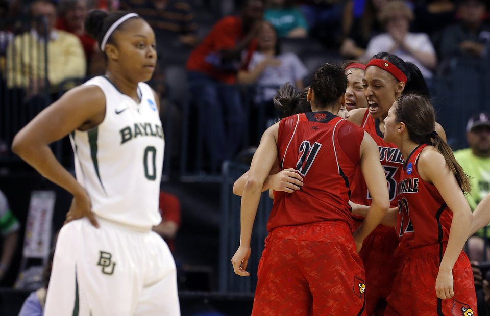 Photo - UNIVERSITY OF LOUISVILLE / NCAA TOURNAMENT / CELEBRATION: Louisville celebrates in front of Baylor's Odyssey Sims (0) during college basketball game between Baylor University and Louisville at the Oklahoma City Regional for the NCAA women's college basketball tournament at Chesapeake Energy Arena in Oklahoma City, Sunday, March 31, 2013. Photo by Sarah Phipps, The Oklahoman