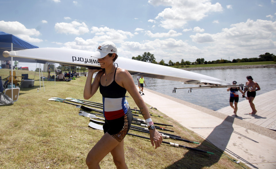 Veronica Scheer with the Texas Rowing Club carries her boat out of the water during the USRowing Masters National Championships on the Oklahoma River, Sunday, Aug. 14, 2011. Photo by Sarah Phipps, The Oklahoman
