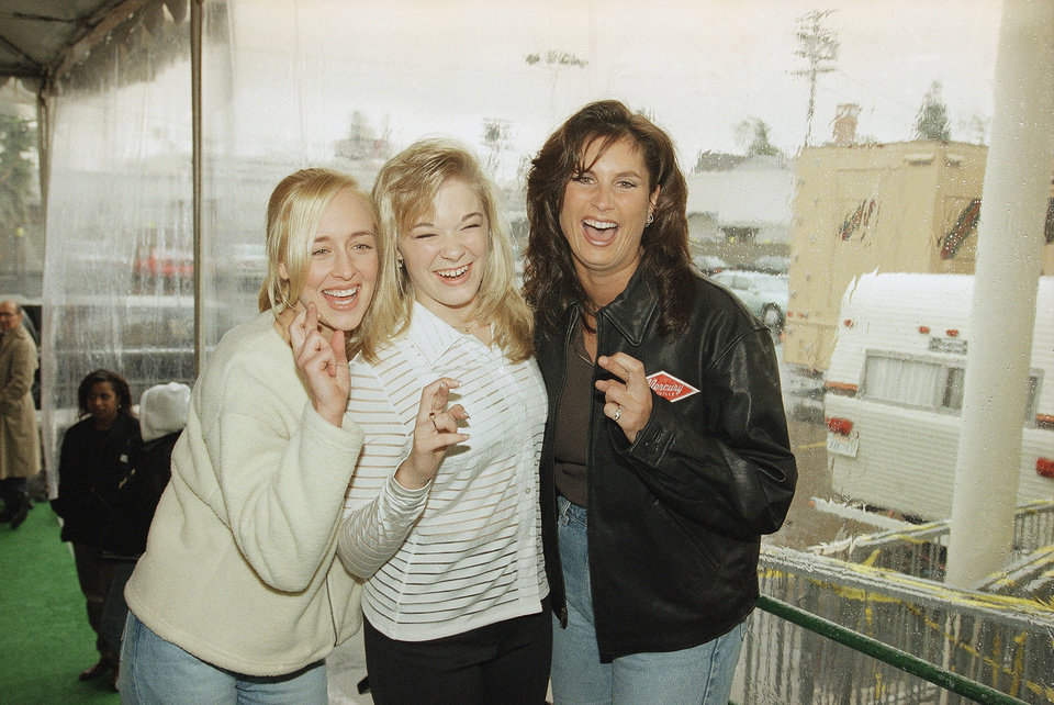 Photo - FILE - In this Jan. 26, 1997 file photo, country music singers Mindy McCready, left, LeAnn Rimes and Terri Clark joke around after a rehearsal for the American Music Awards at the Shrine Auditorium in Los Angeles. McCready, who hit the top of the country charts before personal problems sidetracked her career, died Sunday, Feb. 17, 2013. She was 37. (AP Photo/Michael Caulfield, File)