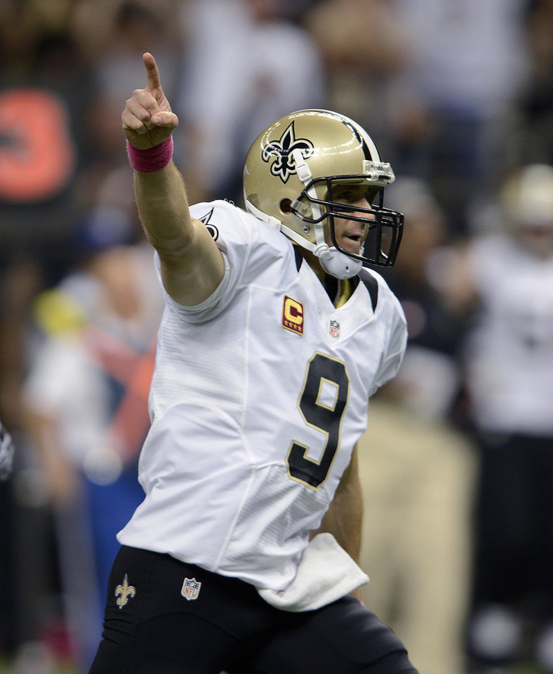 New Orleans Saints quarterback Drew Brees (9) reacts after completing a touchdown pass for his 48th consecutive game, breaking Johnny Unitas\' NFL record which stood for over 50 years, during an NFL football game against the San Diego Chargers at the Mercedes-Benz Superdome in New Orleans, Sunday, Oct. 7, 2012. (AP Photo/Bill Feig)