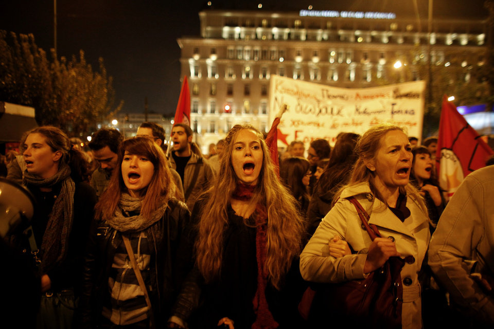 Protesters chant slogans in front of the Greek Parliament during an anti-austerity protest in Athens, Thursday, Nov. 3 2011. Greece\'s prime minister abandoned his explosive plan to put a European rescue deal to popular vote and opened emergency talks Thursday with his opponents, demanding their support in parliament to pass the hard-fought agreement into law. (AP Photo/Kostas Tsironis) ORG XMIT: ATH113