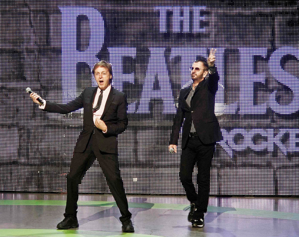 "Beatles Paul McCartney, left, and Ringo Starr are seen at the launch of ""The Beatles: Rock Band"" Xbox game Monday at the Microsoft Xbox 360 E3 Expo in Los Angeles. AP PHOTO"