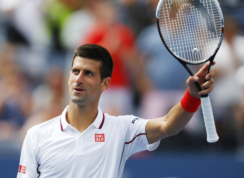 Photo - Novak Djokovic, of Serbia, waves to the crowd after defeating Sam Querrey, of the United States, during the third round of the 2014 U.S. Open tennis tournament, Saturday, Aug. 30, 2014, in New York. (AP Photo/Matt Rourke)