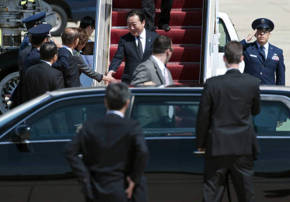Photo -   Japanese Prime Minister Yoshihiko Noda, center, arrives at Andrews Air Force Base, Md., Sunday, April 29, 2012. President Barack Obama will meet with Noda at the White House, Monday, April 30, 2012. (AP Photo/Cliff Owen)