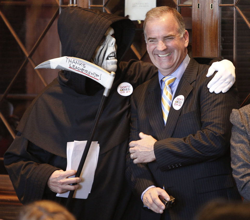 "The ""Grim Reaper"" jokes with Sean Cummings before Governor Mary Fallin's announcement for plans to put tobacco regulations aimed at reducing second hand smoke to a vote of the people at the State Capitol in Oklahoma City, Tuesday February  19, 2013. Photo By Steve Gooch, The Oklahoman"