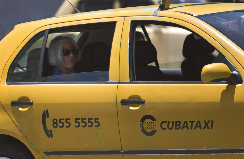Photo - Judy Gross, wife of imprisoned U.S. government subcontractor Alan Gross, leaves in a taxi after an interview in Old Havana, Cuba, Wednesday, June 25, 2014. Gross is in Havana to visit her jailed husband. She said in a statement she worries he will