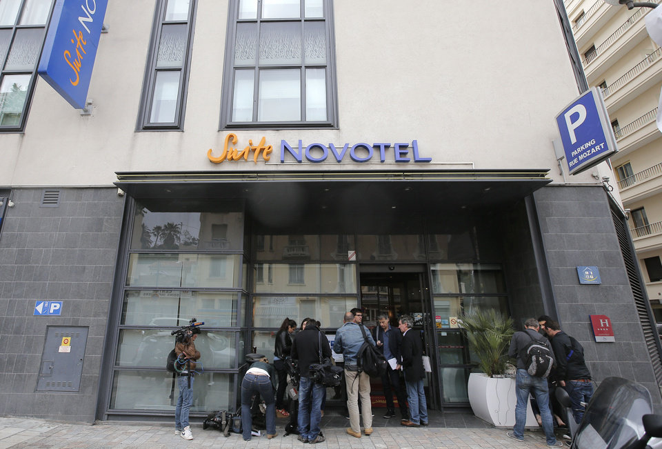 Photo - Reporters gather outside the Novotel hotel during the 66th international film festival, in Cannes, southern France, Friday, May 17, 2013. A French police official says a thief or thieves stole about $1 million worth in jewelry inside a safe in a Novotel hotel room, against the backdrop of the Riviera resort town's film festival. (AP Photo/Lionel Cironneau)