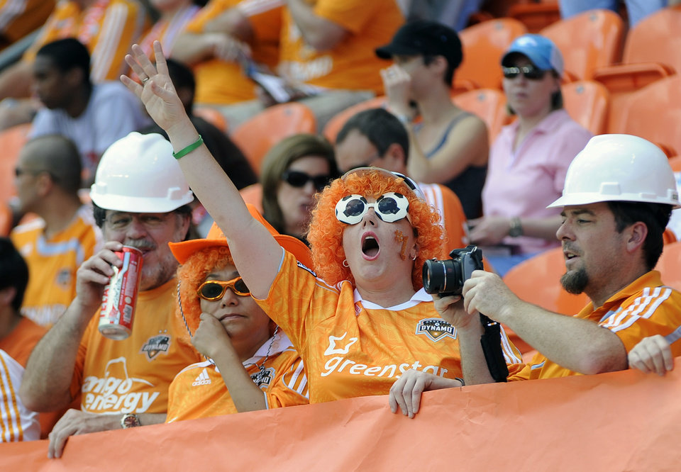 Houston Dynamo fans cheers during in the first half of an MLS soccer match against D.C. United on Saturday, May 12, 2012, in Houston. (AP Photo/Pat Sullivan)