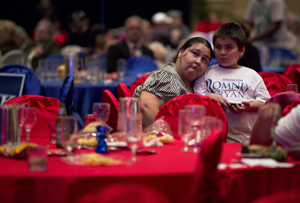Mitt Romney supporter Tammy Plaster watches presidential election returns with her son, Noah Plaster, 7, Tuesday, Nov. 6, 2012, in Las Vegas. (AP Photo/Julie Jacobson)