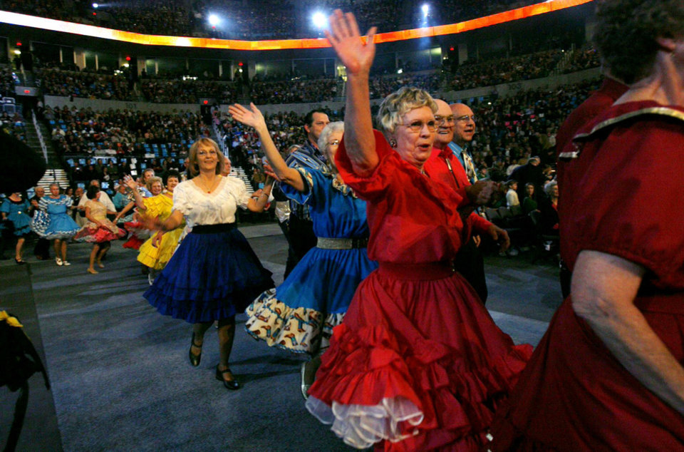 Photo - CONCERT: Square dancers perform during the Centennial Spectacular to celebrate the 100th birthday of the State of Oklahoma at the Ford Center on Friday, Nov. 16, 2007, in Oklahoma City, Okla.   STAFF PHOTO BY CHRIS LANDSBERGER/THE OKLAHOMAN  ORG XMIT: KOD