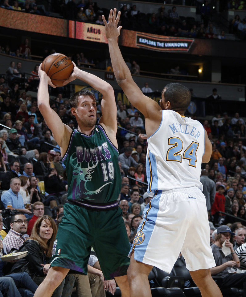 Photo - Milwaukee Bucks guard Beno Udrih, left, looks to pass the ball around Denver Nuggets guard Andre Miller in the first quarter of an NBA basketball game in Denver on Tuesday, Feb. 5, 2013. (AP Photo/David Zalubowski)