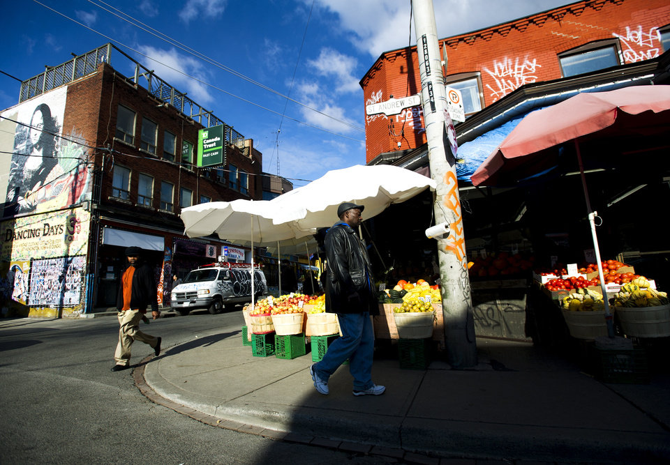 Photo -   This Nov. 14, 2012 photo shows people walking around at Kensington Market in Toronto. Pedestrian Sundays are always fun when the streets are filled with bands, buskers and Brazilian drummers. (AP Photo/The Canadian Press, Nathan Denette)