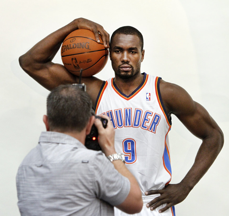 Serge Ibaka poses for photos during media day with the Oklahoma City Thunder in Oklahoma City, Thursday September  27, 2013. Photo By Steve Gooch, The Oklahoman