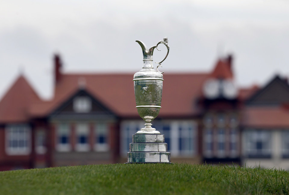 Photo - FILE - In this April 23, 2014, file photo, the British Open Golf trophy the