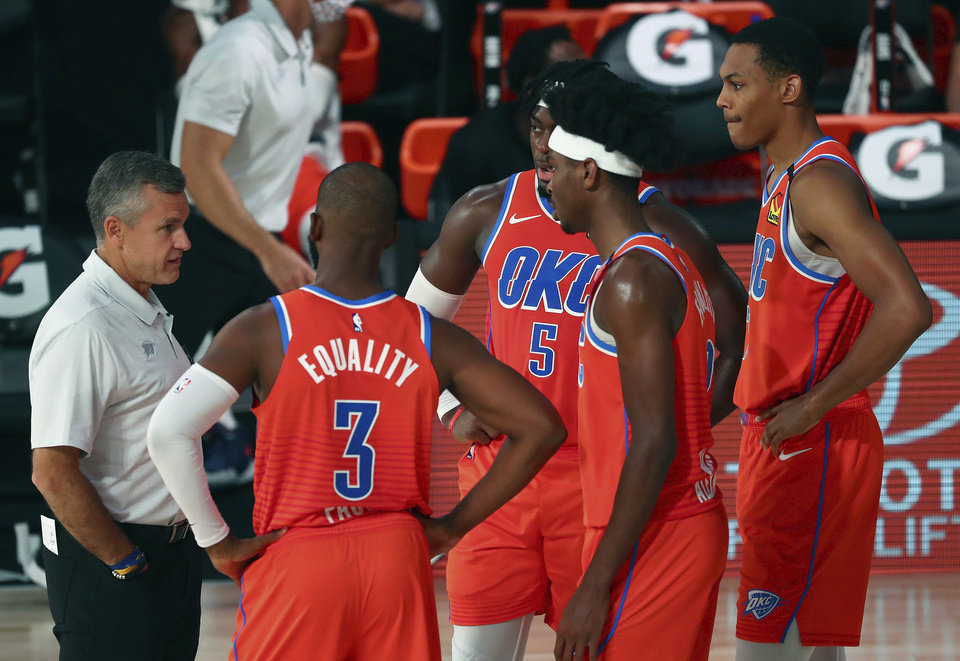 Photo -  Thunder head coach Billy Donovan speaks with his team during a timeout against the Grizzlies during the first half Friday in Lake Buena Vista, Fla. [Kim Klement/Pool Photo via AP]