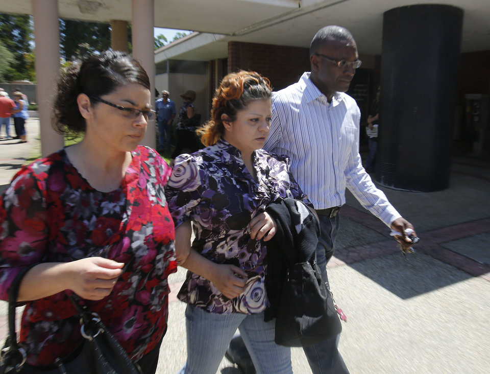 Photo - Priscilla Rodriquez, center, the mother of murder victim of Leila Fowler, leaves the Calaveras County Courthouse, in San Andreas, Calif.,  after the arraignment of  her 12-year-old son for Leila's  murder, Wednesday, May 15, 2013.  Leila Fowler, 8, was stabbed to death in her Valley Springs home, last month.  The defendant was charged with second-degree murder and a special allegation for use of a dangerous weapon for the death of Leila Fowler. No plea was entered. (AP Photo/Rich Pedroncelli)