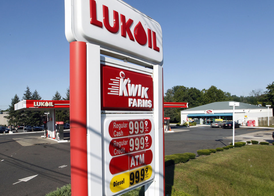 Photo -   A sign says regular gas is $9.99 a gallon at a Lukoil service station Wednesday, Sept. 12, 2012, in Princeton, N.J., as Lukoil dealers and workers protest what they say are unfair pricing practices by Lukoil North America. More than 50 Lukoil gas stations in New Jersey and Pennsylvania were jacking up prices to more than $8 a gallon Wednesday to protest what they say are unfair pricing practices by Lukoil North America that they say leave them at a competitive disadvantage. (AP Photo/Mel Evans)