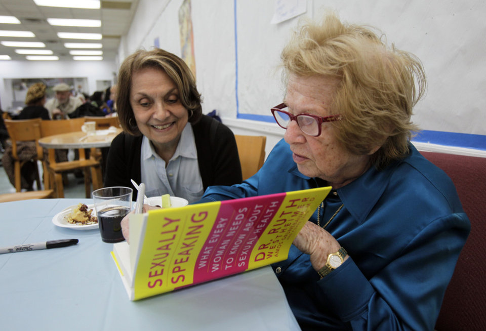 Photo -   In this Thursday, April 26, 2012 photo, Dr. Ruth Westheimer signs a copy of her book for a fan at the National Council of Jewish Women in New York. In 1980, Westheimer broke into late-night radio with