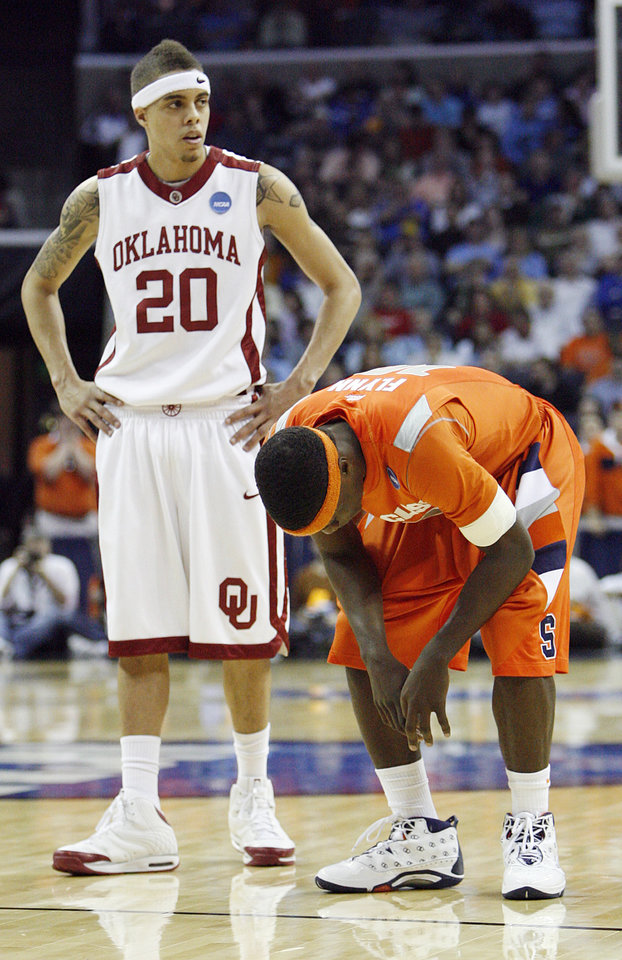 Oklahoma's Austin Johnson (20) stands over Syracuse's Jonny Flynn (10) during the second half of the NCAA Men's Basketball Regional at the FedEx Forum on Friday, March 27, 2009, in Memphis, Tenn.
