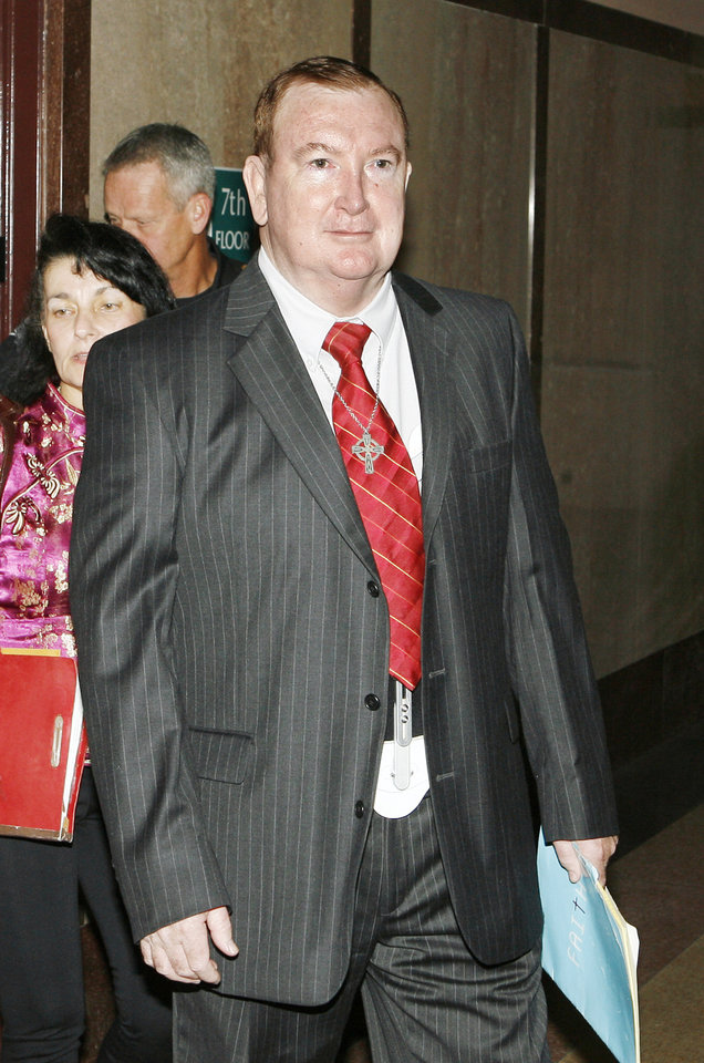 Photo - Pharmacist Jerome Ersland, arrives for his preliminary hearing at the Oklahoma County Courthouse in Oklahoma City Wednesday, Nov. 11, 2009.   Photo by Paul B. Southerland, The Oklahoman ORG XMIT: KOD