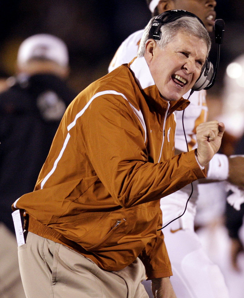 Photo - University of Texas head coach Mack Brown cheers on his team after a touchdown during the first quarter of an NCAA college football game against Missouri Saturday, Oct. 24, 2009, in Columbia, Mo. (AP Photo/Jeff Roberson) ORG XMIT: MOJR107