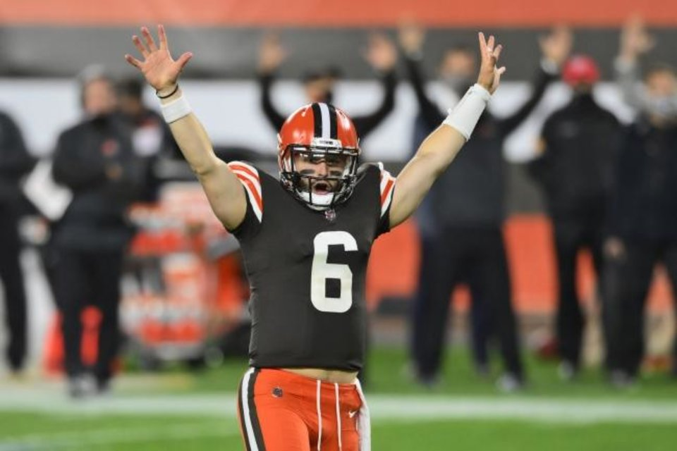 Photo -  Cleveland Browns quarterback Baker Mayfield celebrates after running back Kareem Hunt scored a touchdown during Thursday night's victory over the Cincinnati Bengals in Cleveland. The Browns won 35-30. [AP PHOTO/DAVID RICHARD]