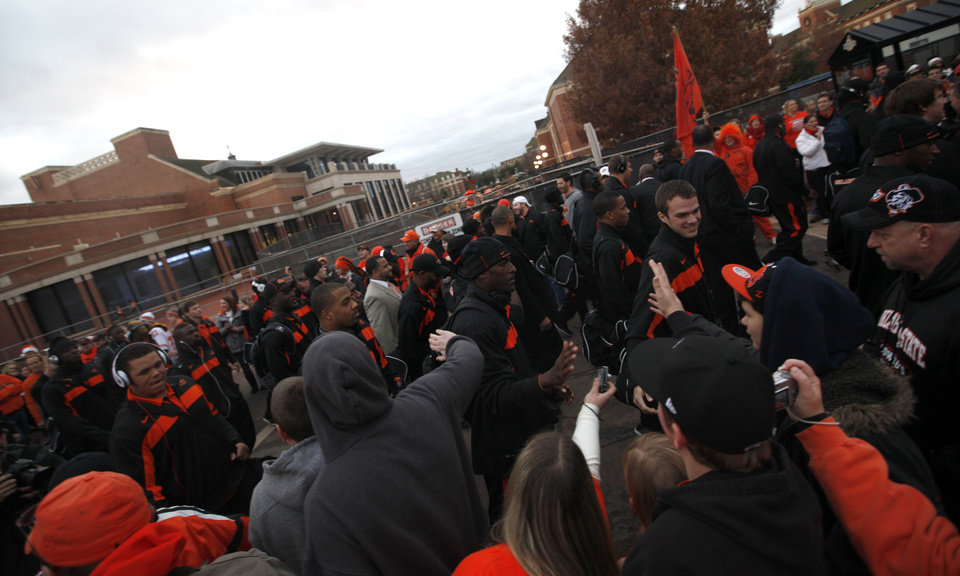 Photo - Fans greet players during the Spirit Walk before the Bedlam college football game between the Oklahoma State University Cowboys (OSU) and the University of Oklahoma Sooners (OU) at Boone Pickens Stadium in Stillwater, Okla., Saturday, Dec. 3, 2011. Photo by Sarah Phipps, The Oklahoman