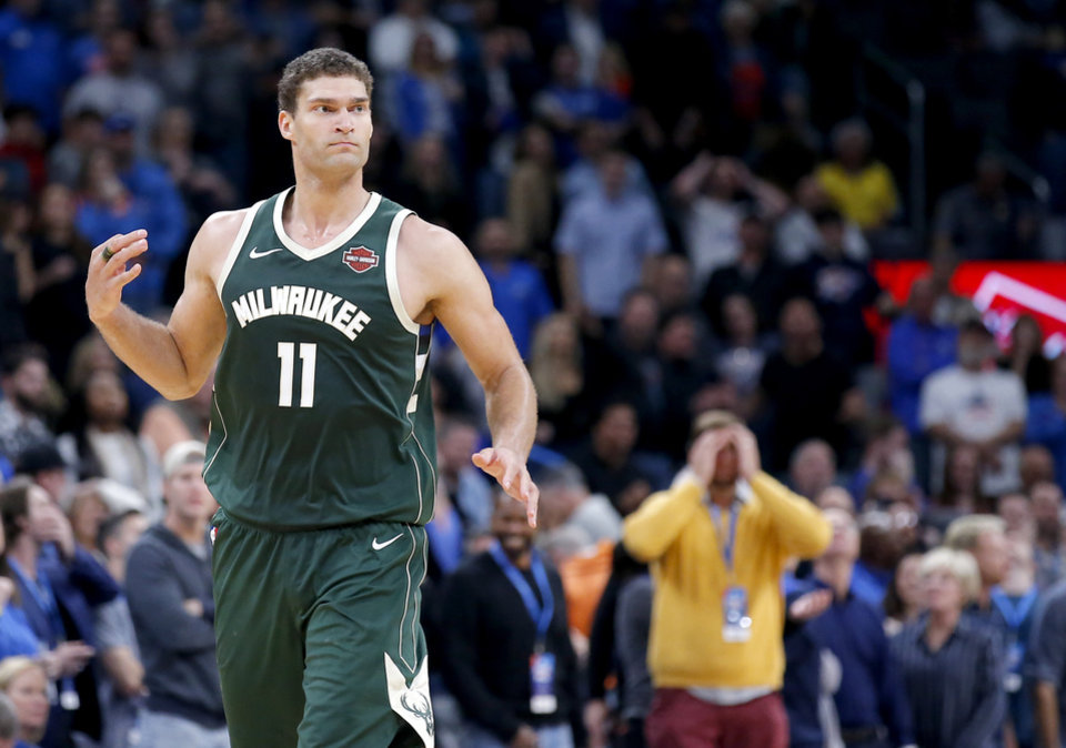 Photo - Milwaukee's Brook Lopez (11) reacts after a 3-point basket late in the fourth quarter during the NBA game between the Oklahoma City Thunder and the Milwaukee Bucks at Chesapeake Energy Arena,   Sunday, Nov. 10, 2019.  [Sarah Phipps/The Oklahoman]
