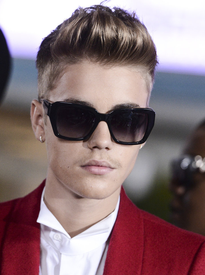 Photo - FILE - Singer Justin Bieber arrives at the premiere of the feature film