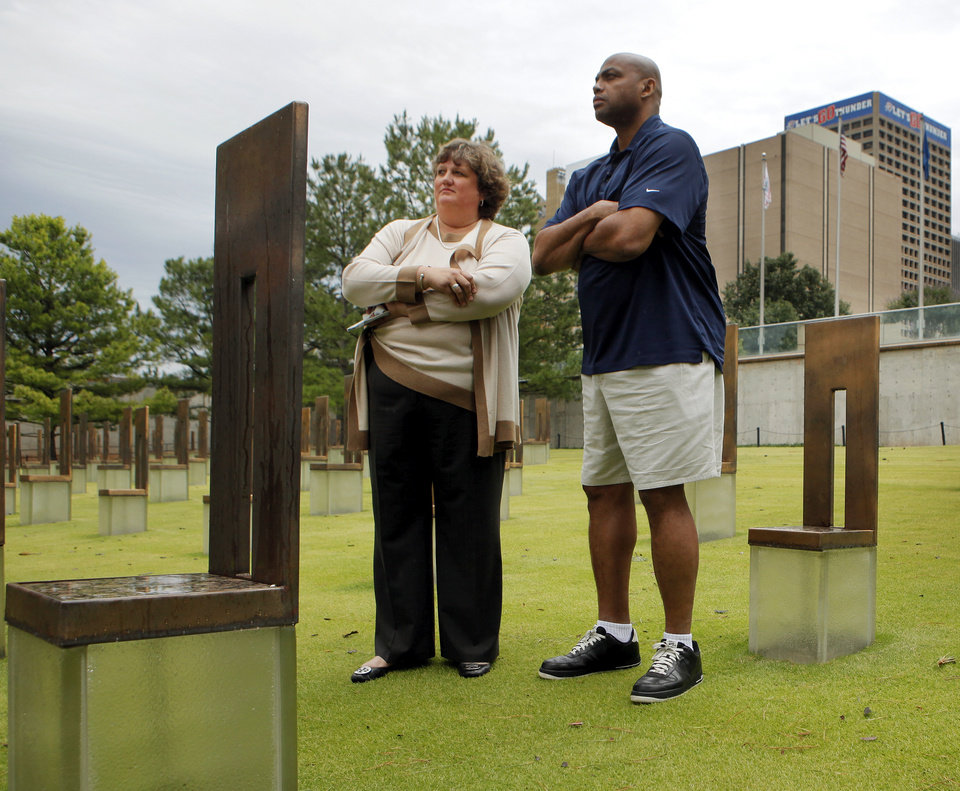 Charles Barkley stands with Kari Watkins, Oklahoma City National Memorial & Museum executive director, during a visit to the Oklahoma City National Memorial in Oklahoma City, Friday, June 1, 2012. Barkley visited the memorial as part of a tour of Oklahoma City. Photo by Nate Billings, The Oklahoman