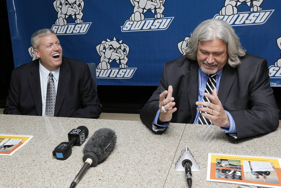 Photo - Rex Ryan, left, laughs as his brother Rob Ryan tells a story during a press conference before the SWOSU Athletics Hall of Fame banquet to honor the Ryan brothers at Southwestern Oklahoma State University in Weatherford, Okla., Saturday, Feb. 18, 2012. Photo by Nate Billings, The Oklahoman