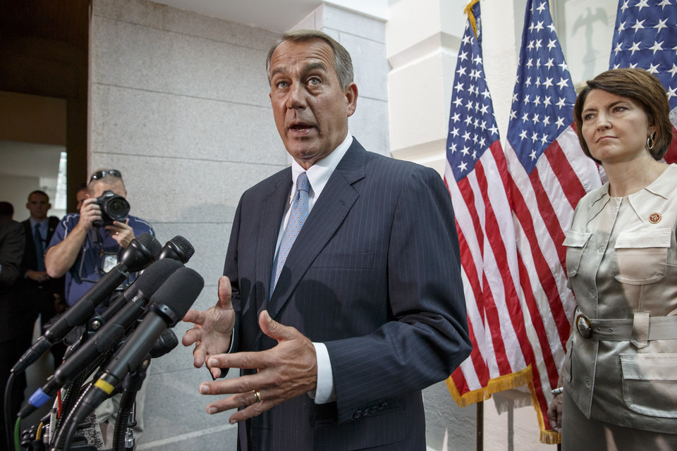 Photo - House Speaker John Boehner of Ohio, accompanied by Rep. Cathy McMorris Rodgers, R-Wash., tells reporters on Capitol Hill in Washington, Wednesday, June 18, 2014, that the US should not be talking to Iran about a joint effort to help the Iraqi government battle insurgents who have been overrunning large swaths of that country, before heading to the White House to meet with President Barack Obama on the crisis. Boehner said that reaching out to Iran would be the wrong message to send U.S. allies in the Middle East, even as Iran is alleged to have sponsored terrorism in that region.  (AP Photo/J. Scott Applewhite)